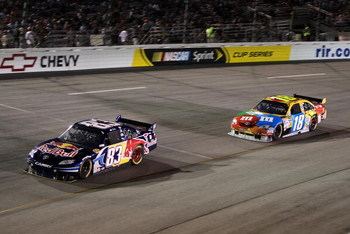 RICHMOND, VA - SEPTEMBER 12:  Brian Vickers, driver of the #83 Red Bull Toyota, leads Kyle Busch, driver of the #18 M&M's Toyota during the NASCAR Sprint Cup Series Chevy Rock & Roll 400 at Richmond International Raceway on September 12, 2009 in Richmond,