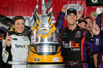 RICHMOND, VA - SEPTEMBER 12:  Denny Hamlin, driver of the #11 FedEx Toyota, celebrates in victory lane after winning the NASCAR Sprint Cup Series Chevy Rock & Roll 400 at Richmond International Raceway on September 12, 2009 in Richmond, Virginia.  (Photo
