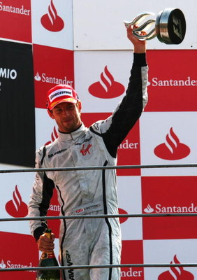 MONZA, ITALY - SEPTEMBER 13:  Second placed Jenson Button of Great Britain and Brawn GP celebrates on the podium following the Italian Formula One Grand Prix at the Autodromo Nazionale di Monza on September 13, 2009 in Monza, Italy.  (Photo by Clive Rose/