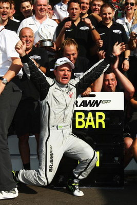 MONZA, ITALY - SEPTEMBER 13:  Rubens Barrichello of Brazil and Brawn GP celebrates with team mates in the paddock after winning the Italian Formula One Grand Prix at the Autodromo Nazionale di Monza on September 13, 2009 in Monza, Italy.  (Photo by Clive