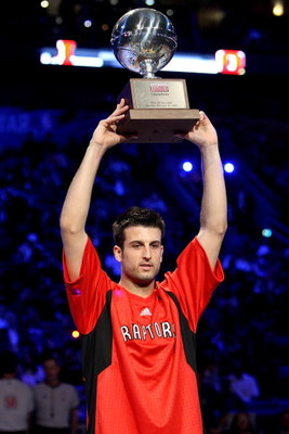 NEW ORLEANS - FEBRUARY 16:  Jason Kapono of the Toronto Raptors holds up the championship trophy after winning the Foot Locker Three-Point Shootout, part of 2008 NBA All-Star Weekend at the New Orleans Arena on February 16, 2008 in New Orleans, Louisiana.