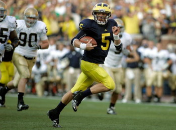 ANN ARBOR, MI - SEPTEMBER 12:  Quarterback Tate Forcier #5 of Michigan runs for a touchdown late in the fourth quarter against Notre Dame at Michigan Stadium on September 12, 2009 in Ann Arbor, Michigan.  (Photo by Domenic Centofanti/Getty Images)