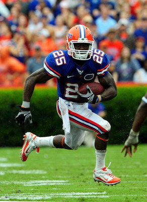 GAINESVILLE, FL - SEPTEMBER 12:  Brandon James #25 runs for a touchdown during the game against the Troy Trojans at Ben Hill Griffin Stadium on September 12, 2009 in Gainesville, Florida.  (Photo by Sam Greenwood/Getty Images)