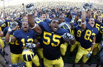 ANN ARBOR, MI - SEPTEMBER 05:  Brandon Graham #55 of the Michigan Wolverines leads his teammates in singing the schools fight song after beating the Western Michigan Broncos 31-7 on September 5, 2009 at Michigan Stadium in Ann Arbor, Michigan.  (Photo by