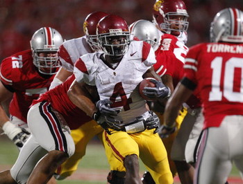 COLUMBUS, OH - SEPTEMBER 13:  Joe McKnight #4 of the Southern California Trojans looks for running room while playing the Ohio State Buckeyes on September 13, 2009 at Ohio Stadium in Columbus, Ohio. USC won the game 18-15. (Photo by Gregory Shamus/Getty I