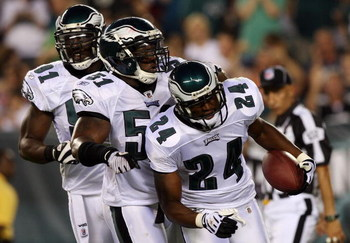 PHILADELPHIA - AUGUST 13:  Sheldon Brown #24 of the Philadelphia Eagles celebrates his interception against the New England Patriots with teammates Chris Clemons #91 and Joe Mays #51 on August 13, 2009 at Lincoln Financial Field in Philadelphia, Pennsylva