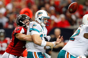 ATLANTA - SEPTEMBER 13:  Kroy Biermann #71 of the Atlanta Falcons forces a fumble by quarterback Chad Pennington #10 of the Miami Dolphins at Georgia Dome on September 13, 2009 in Atlanta, Georgia.  (Photo by Kevin C. Cox/Getty Images)