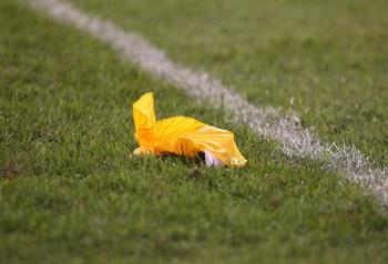 CHICAGO - AUGUST 22: A referees' penalty flag lies on the field during a pre-season game between the Chicago Bears and the New York Giants on August 22, 2009 at Soldier Field in Chicago, Illinois. The Bears defeated the Giants 17-3. (Photo by Jonathan Dan