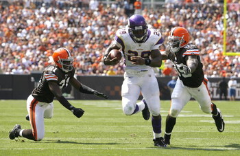CLEVELAND - SEPTEMBER 13:  Adrian Peterson #28 of the Minnesota Vikings runs by Brodney Pool #21 and Corey Willams #99 of the Cleveland Brwons at Cleveland Browns Stadium on September 13, 2009 in Cleveland, Ohio.  (Photo by Matt Sullivan/Getty Images)
