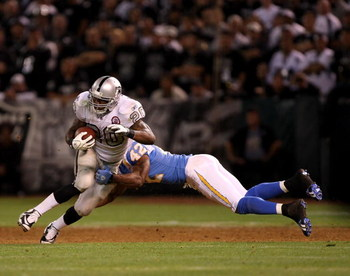 OAKLAND, CA - SEPTEMBER 14:  Darren McFadden #20 of the Oakland Raiders is hit by Clinton Hart #42 of the San Diego Chargers during their game on September 14, 2009 at the Oakland-Alameda County Coliseum in Oakland, California.  (Photo by Ezra Shaw/Getty