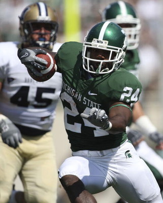 EAST LANSING, MI - SEPTEMBER 05: Running back Caulton Ray #24 of the Michigan State Spartans runs for a short gain during the game against the Montana State Bobcats on September 5, 2009 at Spartan Stadium in East Lansing, Michigan. Michigan State won the