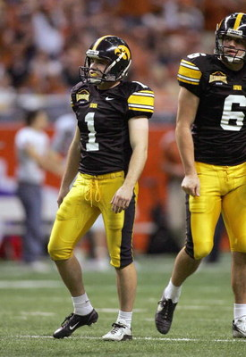 SAN ANTONIO - DECEMBER 30: Kicker Kyle Schlicher #1 of the Iowa Hawkeyes walks off the field against the Texas Longhorns during the Alamo Bowl on December 30, 2006 at the Alamodome in San Antonio, Texas. (Photo by Ronald Martinez/Getty Images)