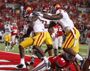 COLUMBUS, OH - SEPTEMBER 13: Joe McKnight #4 of the Southern California Trojans celebrates a two point conversion with David Ausberry #9 while playing the Ohio State Buckeyes on September 13, 2009 at Ohio Stadium in Columbus, Ohio.  (Photo by Gregory Sham