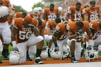AUSTIN, TX - SEPTEMBER 5:  Members of the Texas Longhorns bow their heads together prior to their game against the Louisiana Monroe Warhawks on September 5, 2009 at Darrell K Royal-Texas Memorial Stadium in Austin, Texas. The Longhorns defeated the Warhaw