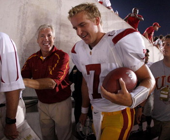 COLUMBUS, OH - SEPTEMBER 13:  Head coach Pete Carroll and Matt Barkley #7 of the Southern California Trojans leave the field after defeating the Ohio State Buckeyes 18-15 on September 13, 2009 at Ohio Stadium in Columbus, Ohio.  (Photo by Gregory Shamus/G