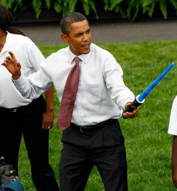 WASHINGTON - SEPTEMBER 16:  U.S. President Barack Obama jokingly attacks Olympic fencer Tim Morehouse during a fencing demonstration on the South Lawn of the White House promoting the city of Chicago�s bid for the 2016 Summer Olympics September 16, 2009 i