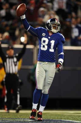 EAST RUTHERFORD, NJ - NOVEMBER 02:  Amani Toomer #81 of the New York Giants scores a touchdown against the Dallas Cowboys during their game on November 2, 2008 at Giants Stadium in East Rutherford, New Jersey.  (Photo by Al Bello/Getty Images)