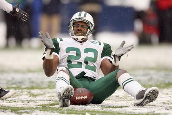 SEATTLE - DECEMBER 21:  Ty Law #22 of the New York Jets reacts after the tackle during the game against the Seattle Seahawks on December 21, 2008 at Qwest Field in Seattle, Washington. The Seahawks defeated the Jets 13-3. (Photo by Otto Greule Jr/Getty Im