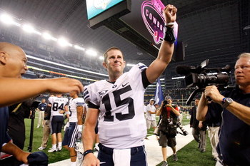 ARLINGTON, TX - SEPTEMBER 05:  Quarterback Max Hall #15 of the Brigham Young Cougars celebrates a 14-13 win against the Oklahoma Sooners at Cowboys Stadium on September 5, 2009 in Arlington, Texas.  (Photo by Ronald Martinez/Getty Images)