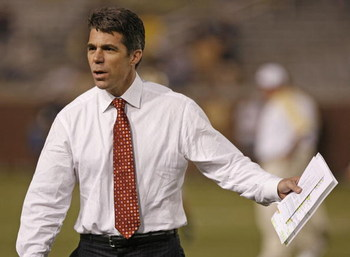 ATLANTA - NOVEMBER 1: ESPN commentator Chris Fowler talks with coaches before the game between the Georgia Tech Yellow Jackets and the Virginia Tech Hokies on November 1, 2007 at Bobby Dodd Stadium at Historic Grant Field in Atlanta, Georgia.  The Hokies 