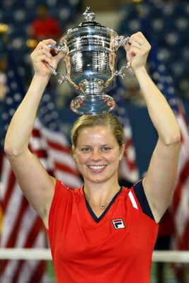 NEW YORK - SEPTEMBER 13:  Kim Clijsters of Belgium holds up the championship trophy after defeating Caroline Wozniacki of Denmark in the Women�s Singles final on day fourteen of the 2009 U.S. Open at the USTA Billie Jean King National Tennis Center on Sep