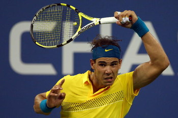 NEW YORK - SEPTEMBER 08:  Rafael Nadal of Spain returns a shot to  Gael Monfils of France during day nine of the 2009 U.S. Open at the USTA Billie Jean King National Tennis Center on September 8, 2009 in the Flushing neighborhood of the Queens borough of