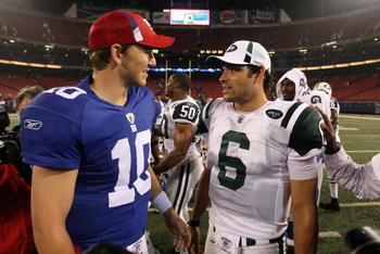 EAST RUTHERFORD, NJ - AUGUST 29:  Eli Manning #10 of the New York Giants talks with Mark Sanchez #6 of the New York Jets after their game on August 29, 2009 at Giants Stadium in East Rutherford, New Jersey.  (Photo by Jim McIsaac/Getty Images)
