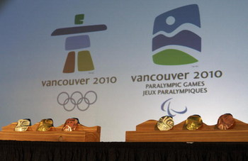 VANCOUVER, BRITISH COLUMBIA - OCTOBER 15:  The medals for the 2010 Olympic (R) and Paralympic Winter Games are displayed following their unveiling October 15, 2009 in Vancouver, British Columbia, Canada.  (Photo by Jeff Vinnick/Getty Images)