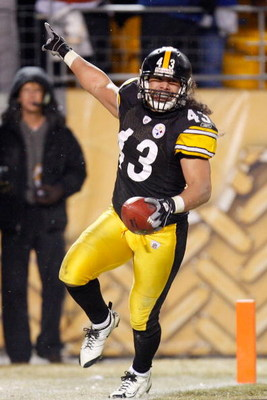 PITTSBURGH - JANUARY 18:  Safety Troy Polamalu #43 of the Pittsburgh Steelers celebrates his touchdown against the Baltimore Ravens during the fourth quarter of the AFC championship game on January 18, 2009 at Heinz Field in Pittsburgh, Pennsylvania.  (Ph