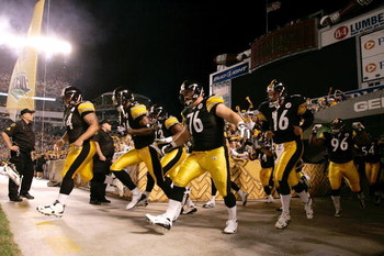 PITTSBURGH, PA - SEPTEMBER 10: Pittsburgh Steelers players run on the field during introductions prior to the game between the Tennessee Titans against the Pittsburgh Steelers at Heinz Field on September 10, 2009 in Pittsburgh, Pennsylvania. The Steelers