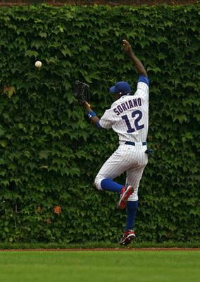 CHICAGO - AUGUST 28: Alfonso Soriano #12 of the Chicago Cubs misses a catch in the outfield against the New York Mets on August 28, 2009 at Wrigley Field in Chicago, Illinois. The Cubs defeated the Mets 5-2. (Photo by Jonathan Daniel/Getty Images)