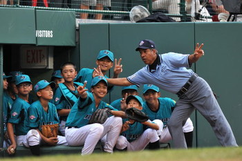 WILLIAMSPORT, PA - AUGUST 29: Asia Pacific (Taoyuan, Taiwan) players pose for a fun photo with the umpire during their game against Mexico (Reynosa) in the International final at Lamade Stadium on August 29, 2009 in Williamsport, Pennsylvania. Taiwan  def