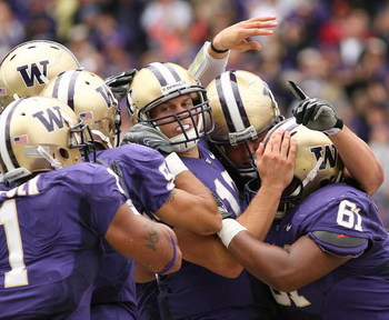 SEATTLE - SEPTEMBER 19:  Quarterback Jake Locker #10 of the Washington Huskies is mobbed by teammates after scoring a touchdown against the USC Trojans on September 19, 2009 at Husky Stadium in Seattle, Washington. The Huskies defeated the Trojans 16-13.