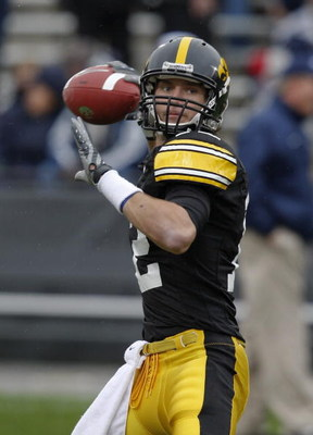 IOWA CITY, IOWA - NOVEMBER 8: Quarterback Ricky Stanzi #12 of the Iowa Hawkeyes looks down field for a receiver during the first quarter of play against the Penn State Nittany Lions at Kinnick Stadium on November 8, 2008 in Iowa City, Iowa. Iowa defeated