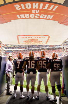 ST. LOUIS, MO - SEPTEMBER 5: Juice Williams #7, Michael Hoomanawanui #16, Doug Pilcher #95 and Sirod Williams #56 all of the University of Illinois Fighting Illini wait to take the field against the University of Missouri Tigers during the State Farm Arch