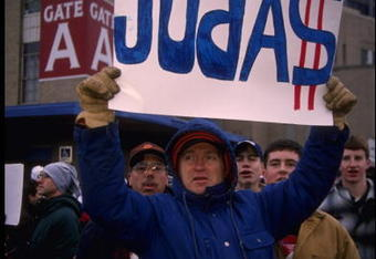 19 Nov 1995: A fan of the Cleveland Browns at Cleveland Stadium in Cleveland, Ohio holds a sign which indicates he believes owner Art Modell betrayed the fans by moving the team to Baltimore, Maryland. The Packers defeated the Browns that day 31-20.
