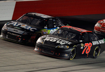 Smith had to hold off a hard charging Carl Edwards for the victory.