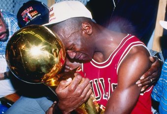 Jordan hugs his first championship trophy in 1991.