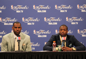 MIAMI, FL - JUNE 02:  (L-R) LeBron James #6 and Dwyane Wade #3 of the Miami Heat answers questions from the media during a post game press conference after they the Heat lost 95-93 against the Dallas Mavericks in Game Two of the 2011 NBA Finals at America