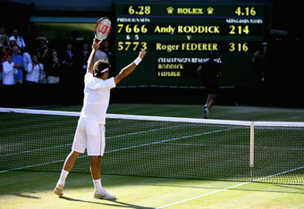WIMBLEDON, ENGLAND - JULY 05:  Roger Federer of Switzerland celebrates victory during the men's singles final match against Andy Roddick of USA on Day Thirteen of the Wimbledon Lawn Tennis Championships at the All England Lawn Tennis and Croquet Club on J