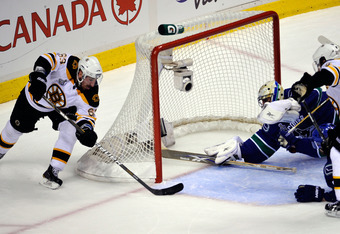 VANCOUVER, BC - JUNE 15:  Brad Marchand #63 of the Boston Bruins scores a goal in the second period against Roberto Luongo #1 of the Vancouver Canucks during Game Seven of the 2011 NHL Stanley Cup Final at Rogers Arena on June 15, 2011 in Vancouver, Briti