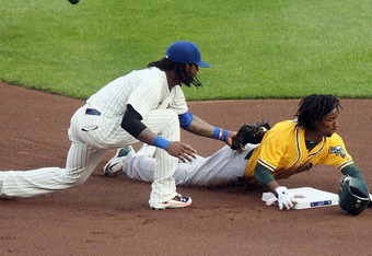 NEW YORK, NY - JUNE 21:  Jemile Weeks #19 of the Oakland Athletics steals second base in the first inning ahead of the tag from Jose Reyes #7 of the New York Mets at Citi Field on June 21, 2011 in the Flushing neighborhood of the Queens borough of New Yor