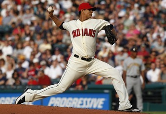 CLEVELAND, OH - JUNE 18:  Carlos Carrasco #59 of the Cleveland Indians pitches against the Pittsburgh Pirates during the second inning of their game on June 18, 2011 at Progressive Field in Cleveland, Ohio.  (Photo by David Maxwell/Getty Images)