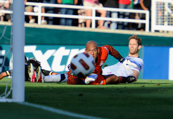 PASADENA, CA - JUNE 25: Goalkeeper Tim Howard #1 of the United States and defender Jonathan Spector #2 look on as the ball passes in front of the net after a kick by Giovanni Dos Santos #10 of Mexico during the 2011 CONCACAF Gold Cup Championship at the R