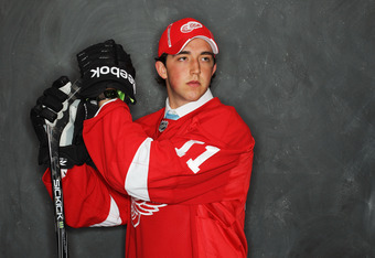 ST PAUL, MN - JUNE 25:  85th overall pick Alan Quine by the Detroit Red Wings poses for a portrait during day two of the 2011 NHL Entry Draft at Xcel Energy Center on June 25, 2011 in St Paul, Minnesota.  (Photo by Nick Laham/Getty Images)