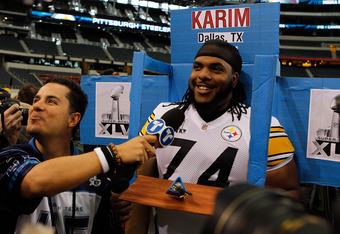 ARLINGTON, TX - FEBRUARY 01:  Willie Colon #74 of the Pittsburgh Steelers gets into a box brought in by a member of Telemundo during Super Bowl XLV Media Day ahead of Super Bowl XLV at Cowboys Stadium on February 1, 2011 in Arlington, Texas. The Pittsburg