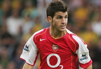 NORWICH, ENGLAND- AUGUST 28:  Francesc Fabregas of Arsenal runs with the ball during the Barclays Premiership match between Norwich City and Arsenal at Carrow Road on August 28, 2004 in Norwich, England. (Photo by Phil Cole/Getty Images)