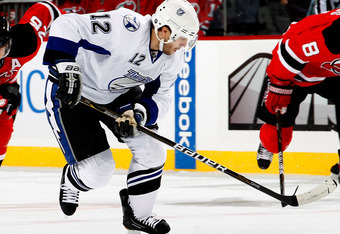 NEWARK, NJ - JANUARY 09:  Simon Gagne #12 of the Tampa Bay Lightning skates during an NHL hockey game against the New Jersey Devils at the Prudential Center on January 9, 2011 in Newark, New Jersey.  (Photo by Paul Bereswill/Getty Images)