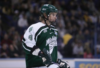 ST. LOUIS - APRIL 7:  Justin Abdelkader #9 of the Michigan State Spartans looks on against the Boston College Eagles in the Frozen Four Championship Game on April 7, 2007 at Scottrade Center in St. Louis, Missouri. Michigan State won 3-1. (Photo by Elsa/G