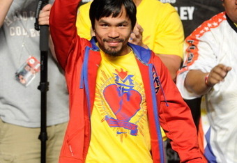 LAS VEGAS, NV - MAY 06:  Boxer Manny Pacquiao of the Philippines greets the crowd before he steps on the scale at 145 pounds before his WBO welterweight title fight against Shane Mosley at MGM Grand Garden Arena on May 6, 2011 in Las Vegas, Nevada. Pacqui